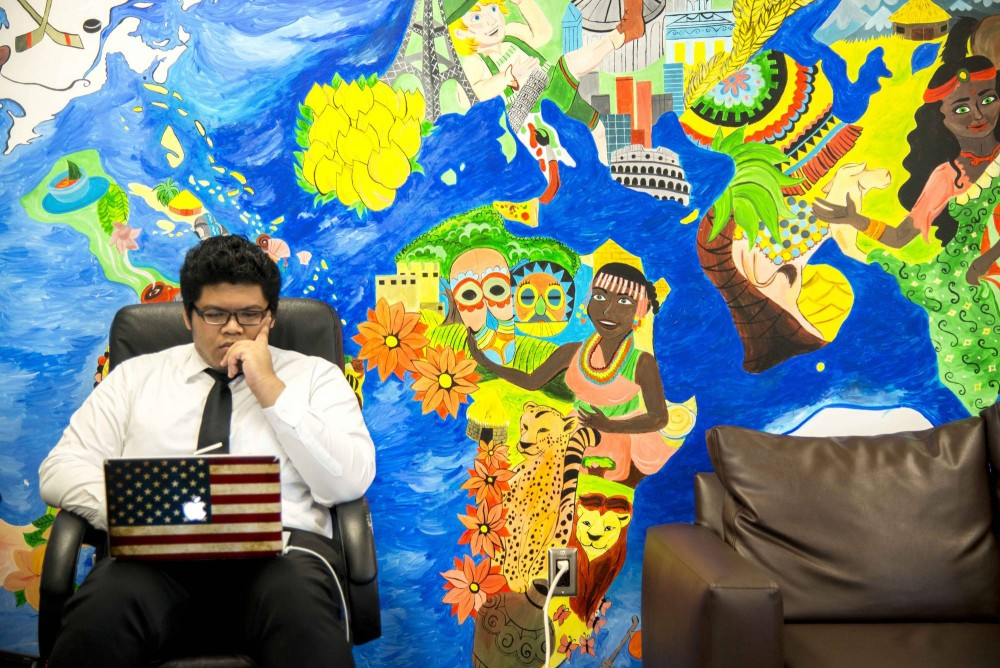 Junior Amar Hasshim studies in the Minnesota International Student Association room of Coffman Union on Wednesday afternoon. MISA unveiled its new piece of wall art last fall after Coffman Union's second floor renovation tore down the original piece.