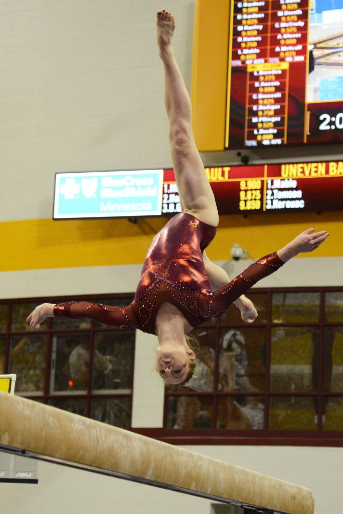 Junior Lindsay Mable performs on the beam on Feb. 28 at the Sports Pavillon.