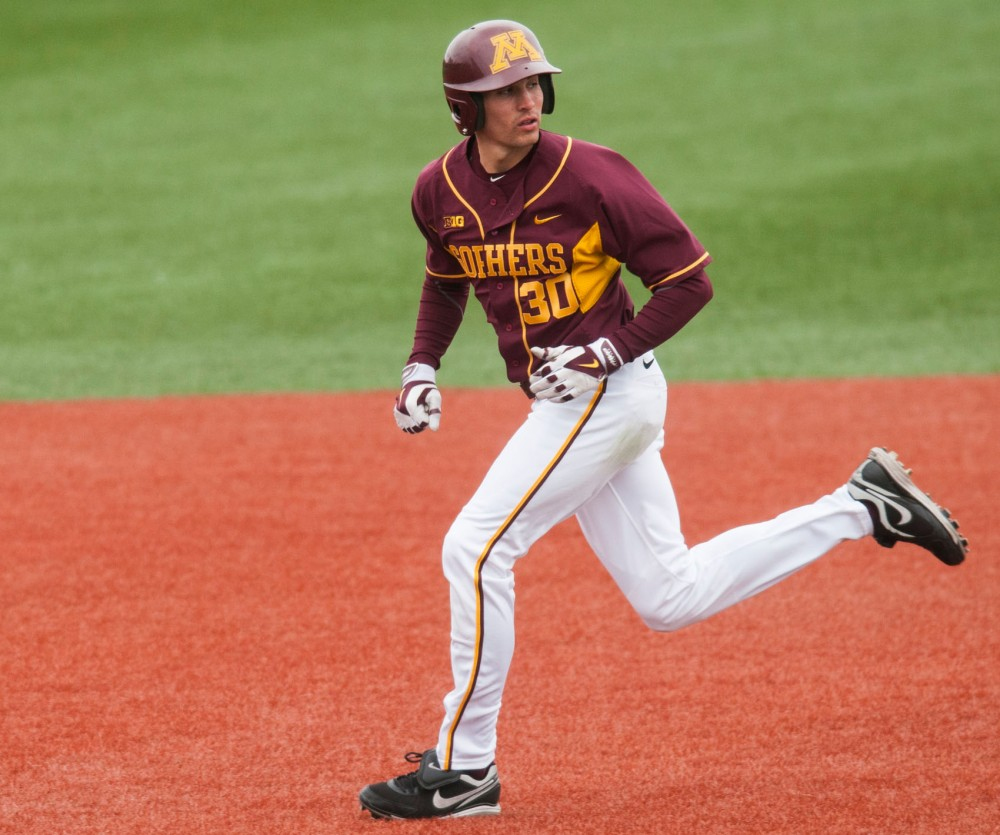 Gophers Dan Motl leads off the base on Feb. 13, 2014 at Seibert Field.