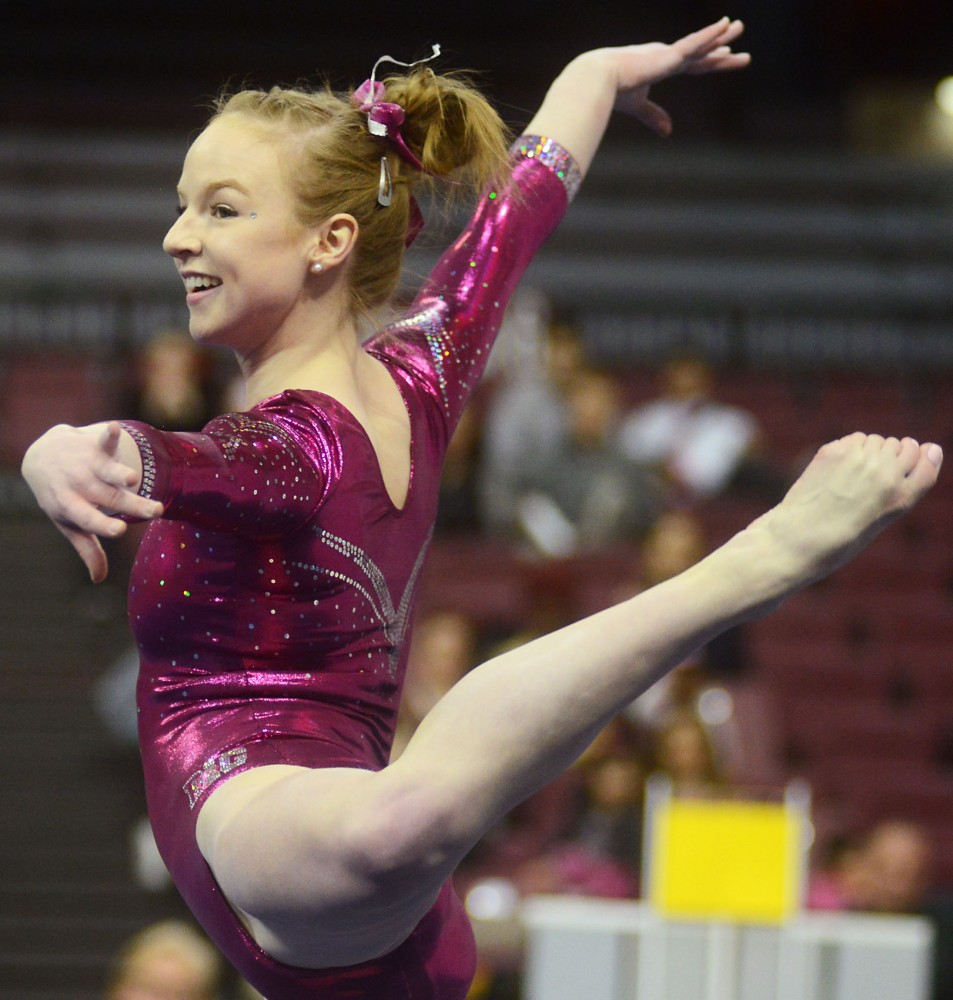 Junior Lindsay Mable performs her floor routine at the Sports Pavilion on Saturday evening where the Gopher Womens Gymnastics took on Nebraska for their annual Pink Meet.