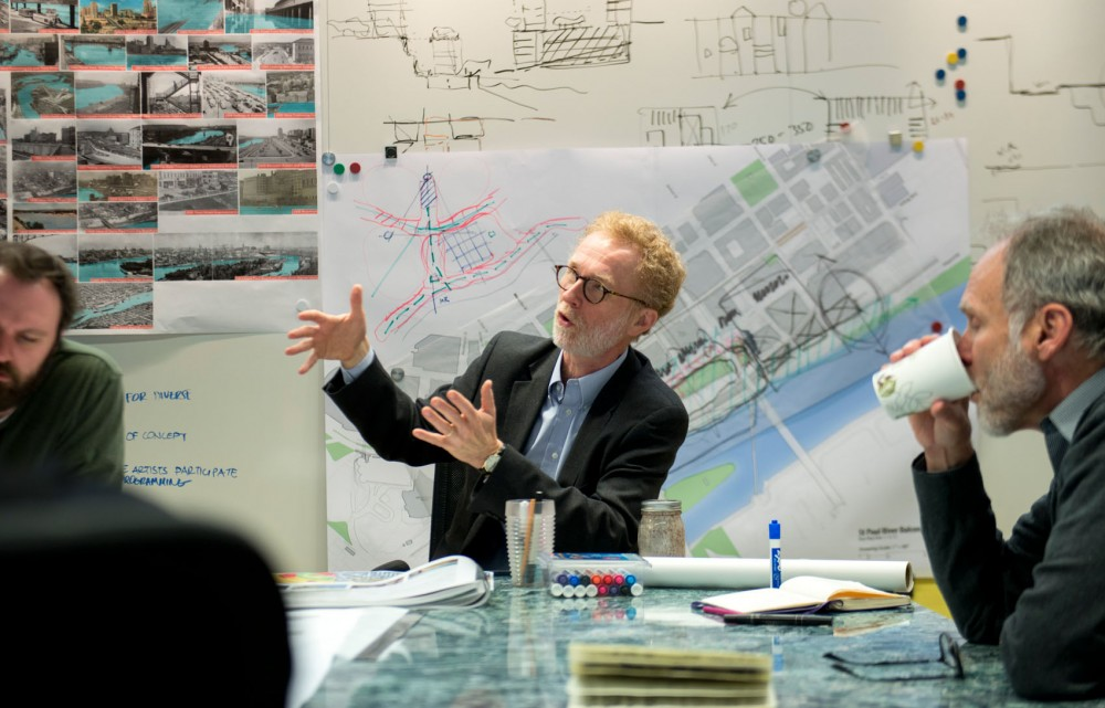 College of Design dean Tom Fisher meets with his staff to discuss an upcoming proposal for the city of St. Paul on Wednesday morning at the Metropolitan Design Center.