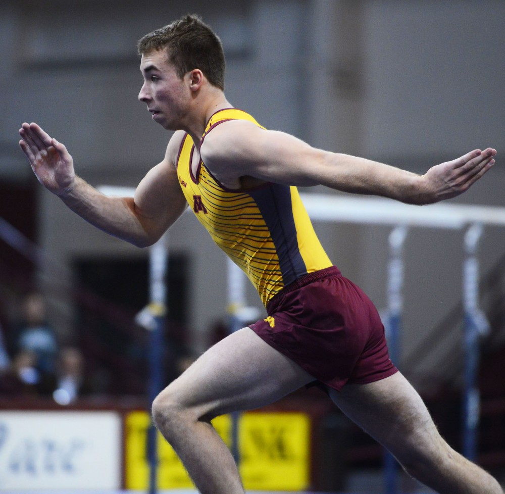 Freshman Joel Gagnon runs swiftly during his floor routine at the Sports Pavilion on Jan. 24 against the Air Force.