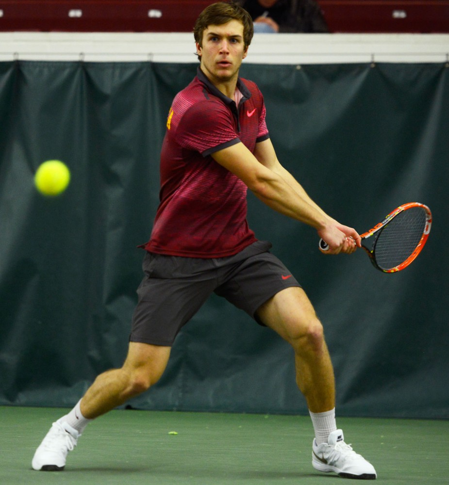 Freshman Matic Spec volleys the ball at the Baseline Tennis Center on March 6 against Washington.