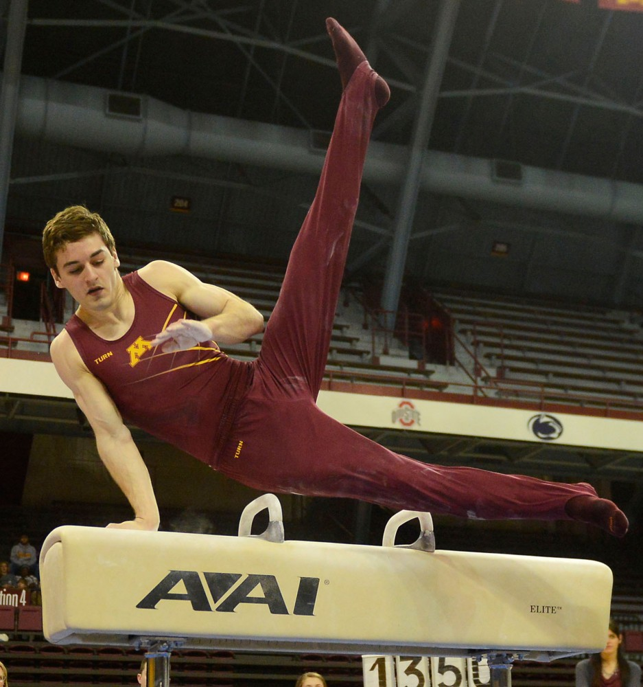Senior Ellis Mannon competes on the pommel horse against Iowa on March 7 at the Sports Pavilion.