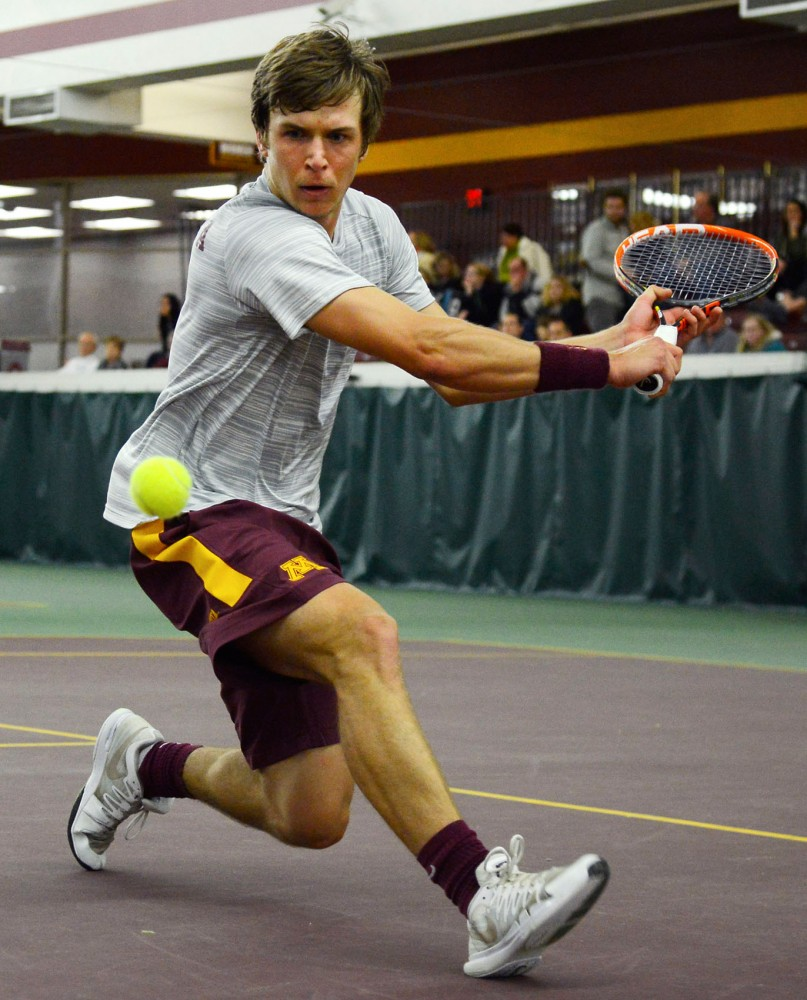 Freshman Matic Spec returns a volley at the Baseline Tennis Center on Friday against Purdue.