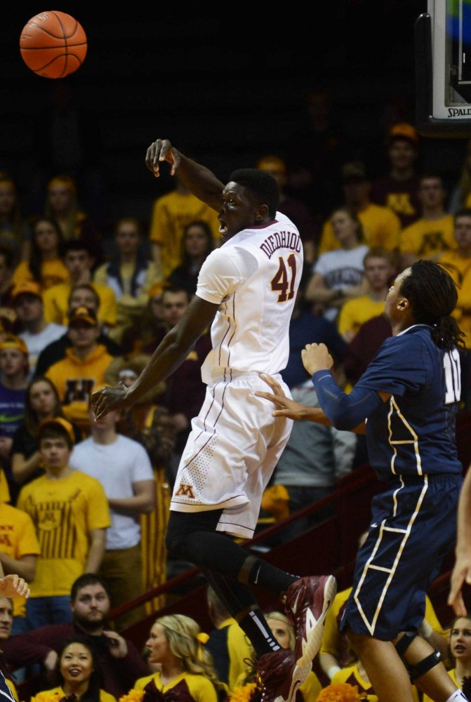 Minnesota forward Gaston Diedhiou passes the ball in the first half against Penn State at Williams Arena on Sunday.