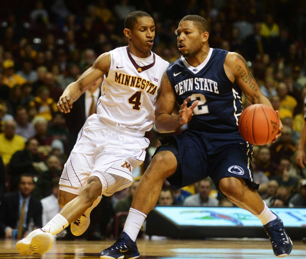 Minnesota guard DeAndre Mathieu defends Penn State guard D.J. Newbill in the first half at Williams Arena on Sunday.