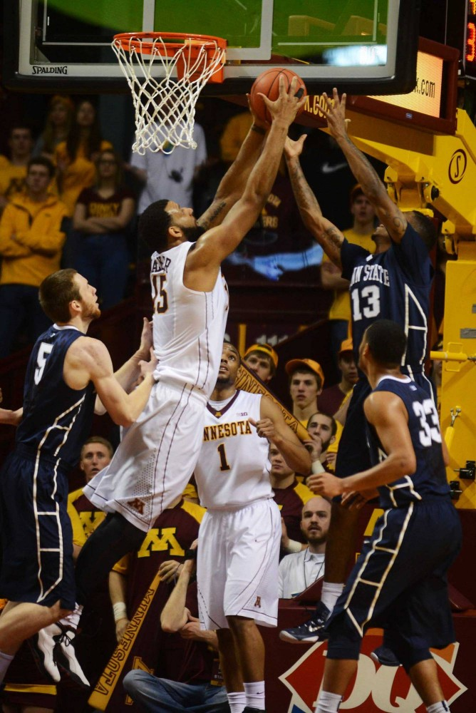 Minnesota forward Maurice Walker reaches for an offensive rebound in the first half against Penn State at Williams Arena on Sunday.