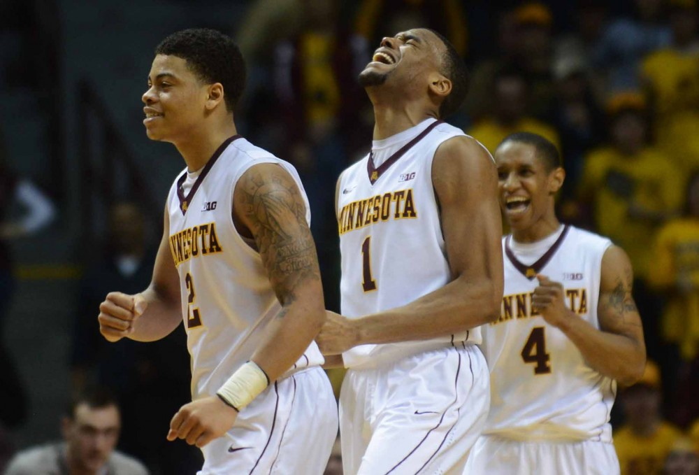Minnesota guards Nate Mason, Andre Hollins and DeAndre Mathieu smile after gaining the lead in the second half against Penn State at Williams Arena on Sunday. Penn State scored a three-pointer in the final seconds of the game to beat Minnesota 79-76.