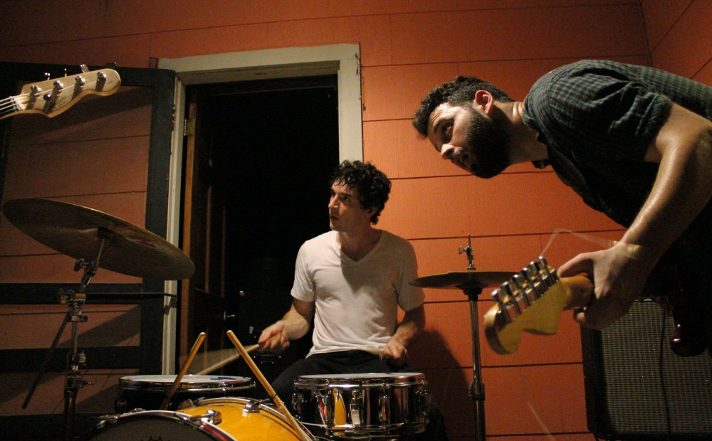 Krill band members Ian Becker and Aaron Ratoff perform at an unofficial house show in Austin, Texas on Thursday, March 19th.