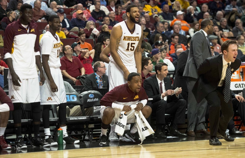 Gophers react to a basket during the second half at the men's Big Ten tournament against Rutgers in Chicago on Wednesday.