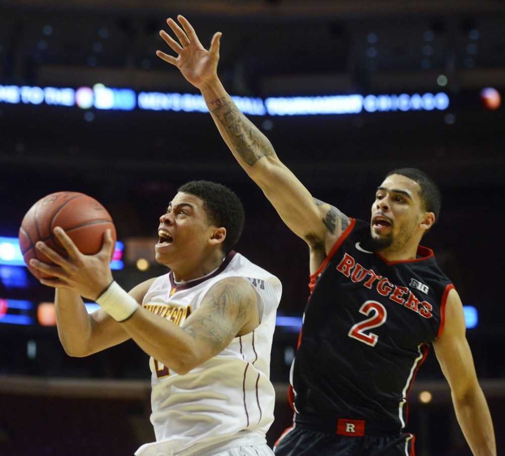 Minnesota's Nate Mason shoots the ball against Rutgers at the men's big ten tournament in Chicago on Wednesday.