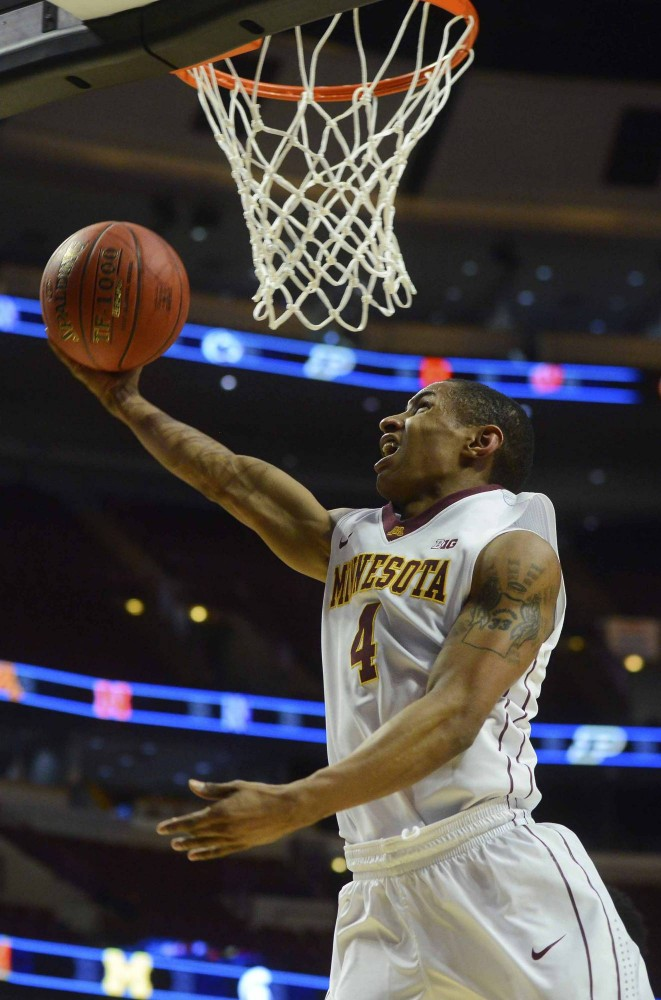 Minnesota's DeAndre Mathieu shoots the ball in the second half at the men's Big Ten tournament in Chicago on Wednesday.