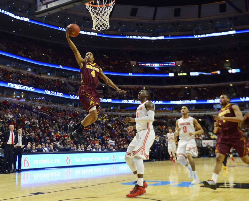 Minnesota guard DeAndre Mathieu scores a basket in the first half against Ohio State in the Big Ten tournament on Thursday in Chicago.