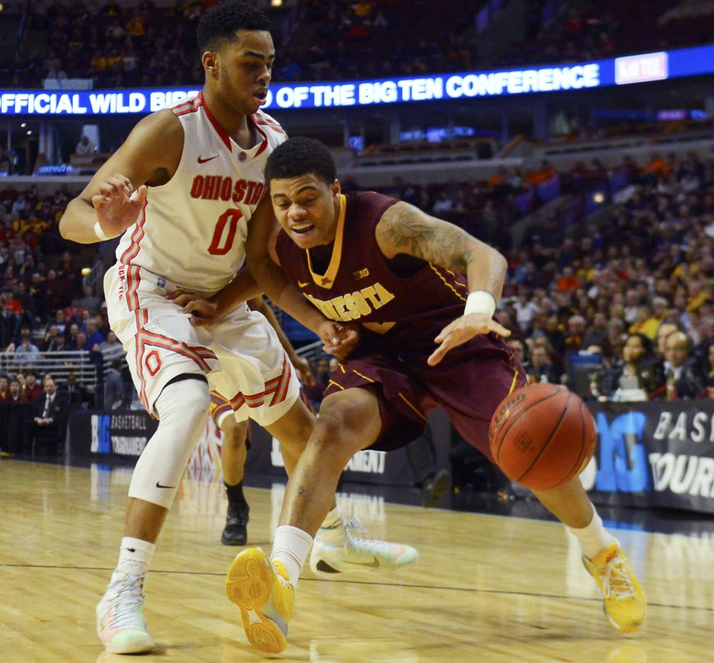 Minnesota guard Nate Mason drives the ball past Ohio State's D'Angelo Russell in the Big Ten tournament on Thursday in Chicago.