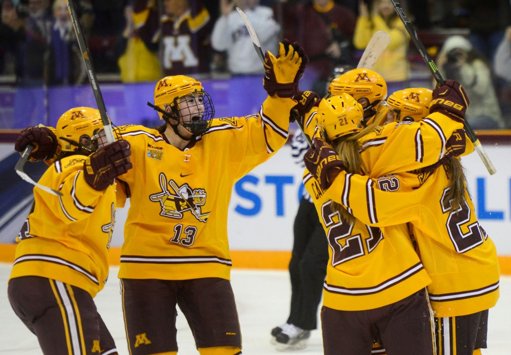 Gophers celebrate after scoring on the Badgers in the NCAA Women's Frozen Four semifinal round in Ridder Arena on Friday, March 20th. Minnesota defeated Wisconsin 3-1, securing their place in the finals on Sunday.