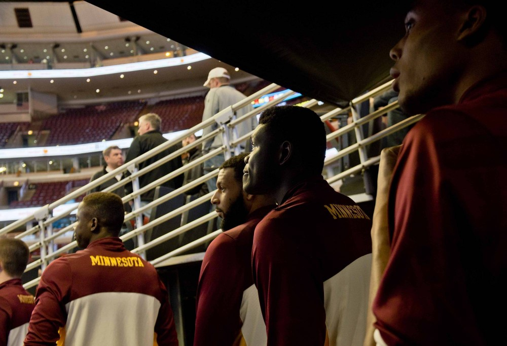 Gophers players walk into the United Center before their game against Rutgers in the men's Big Ten basketball tournament on Wednesday in Chicago.