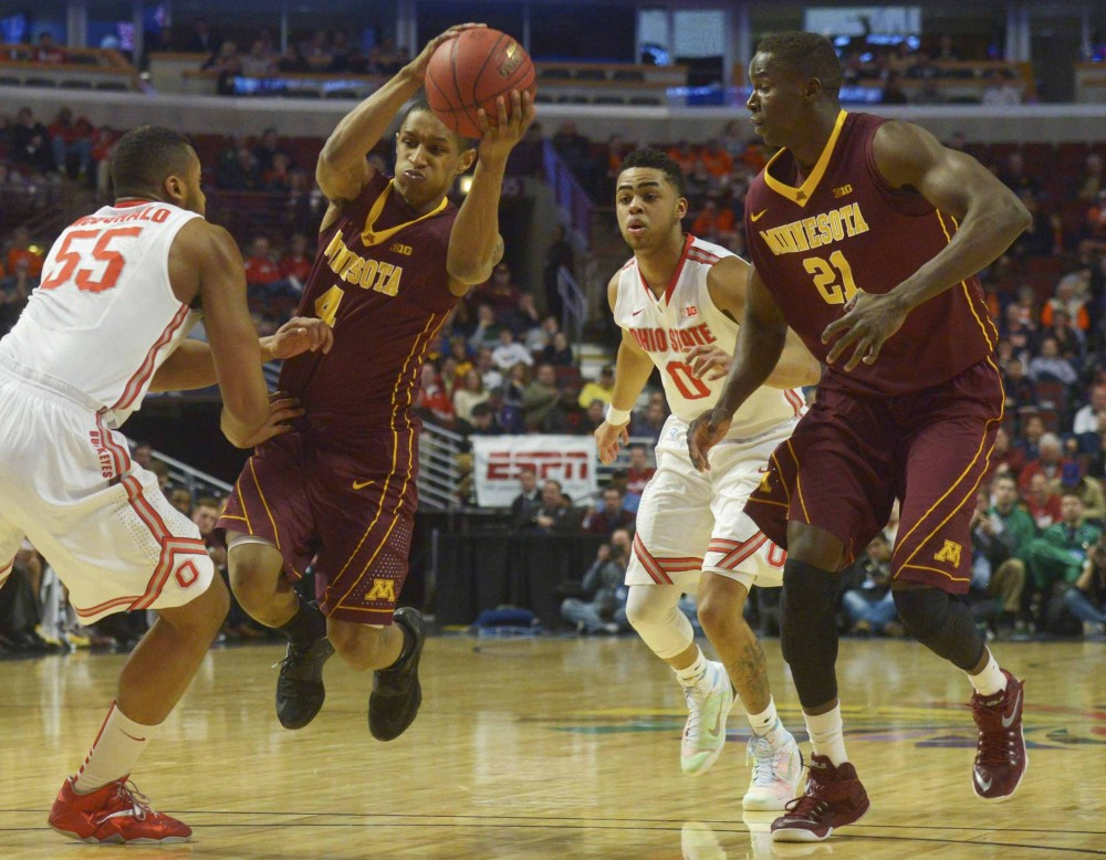 Minnesota guard DeAndre Hollins passes the ball in the first half against Ohio State in the Big Ten tournament on Thursday in Chicago.