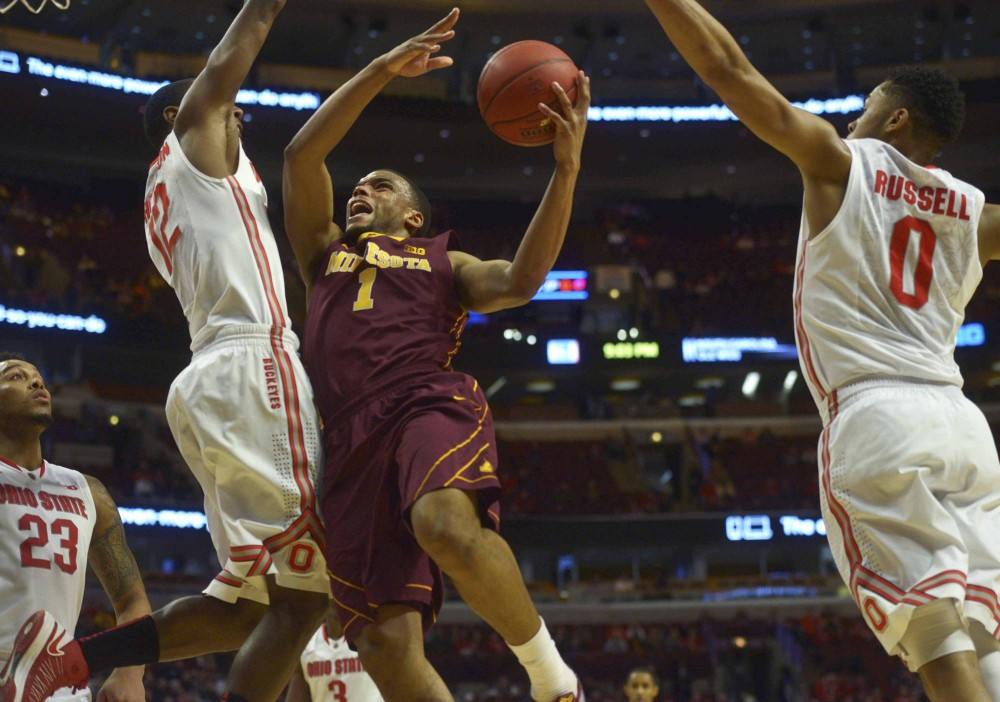 Minnesota guard Andre Hollins shoots the ball in the second half against Ohio State in the Big Ten tournament on Thursday in Chicago.