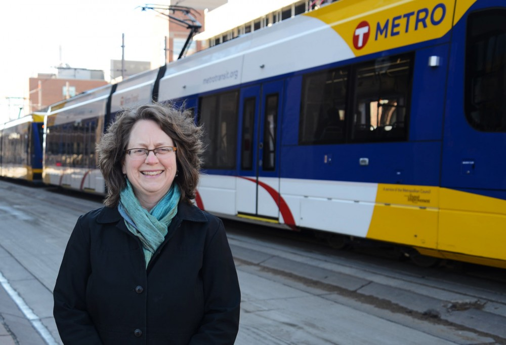Metropolitan Council member Cara Letofsky poses near the light rail stop on Washington on Sunday.  Letofsky is a big supporter of the metro transit system and is on the Transportation Committee.