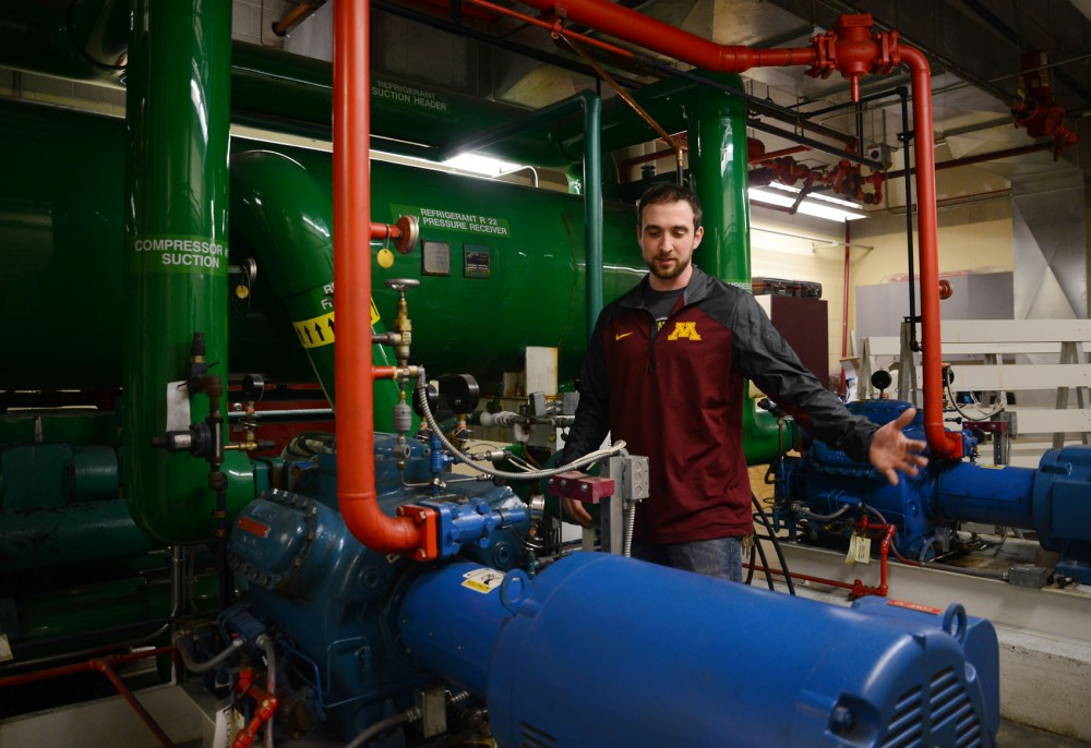 Lead ice maker Adam Stirn explains Ridder Arena's ice refrigerating system on Monday.  The system currently uses the coolant R-22 which is required to be faded out of systems by 2020.