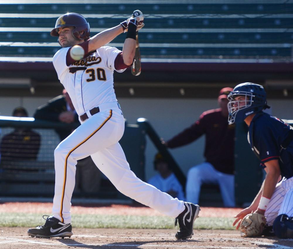 Gophers outfielder Dan Motl swings March 31 at Siebert Field.