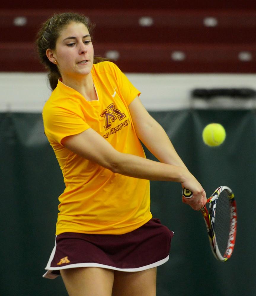 Junior Paula Rincon-Otero hits the ball on Sunday at the Baseline Tennis Center.