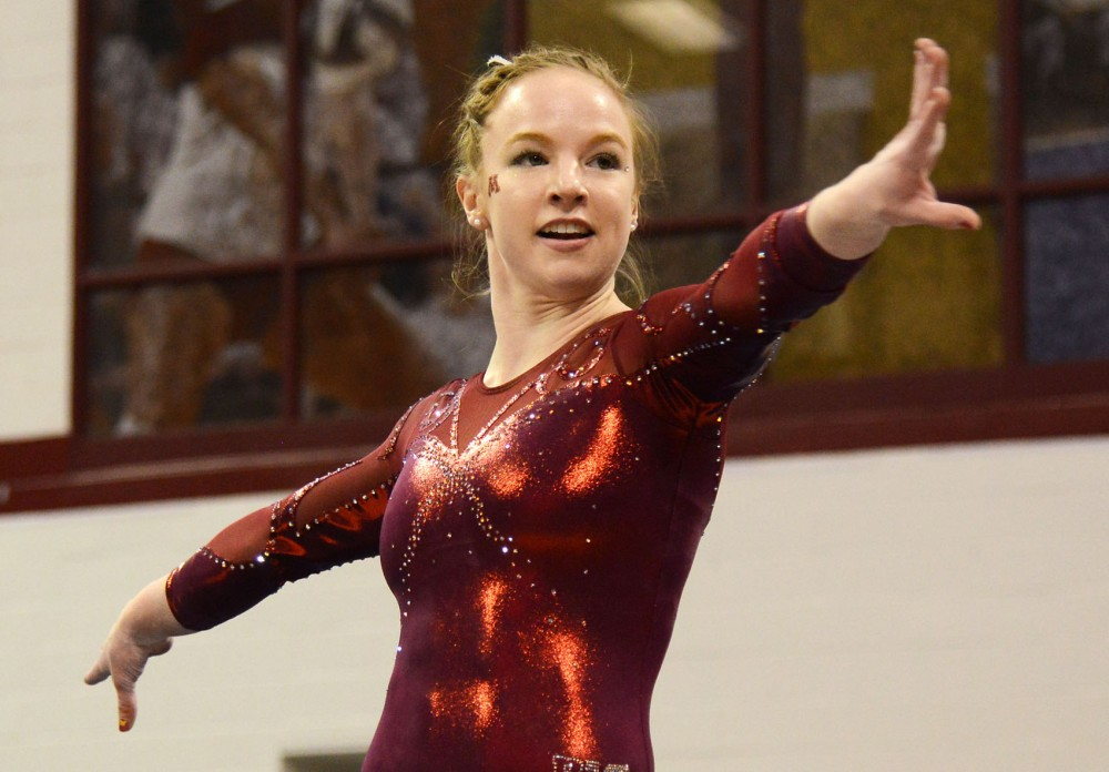 Junior Lindsay Mable poses during her floor routine performance on Feb. 28 at the Sports Pavilion.