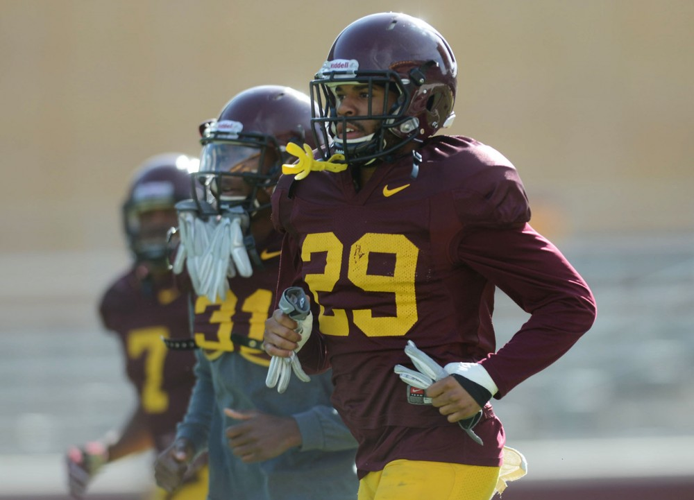 Redshirt junior Briean Boddy-Calhoun warms up at practice at TCF Bank Stadium on Thursday.