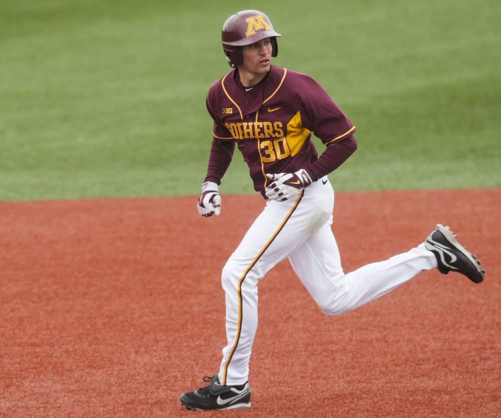 Gophers outfielder Dan Motl leads off the base on April 13, 2014, at Siebert Field.