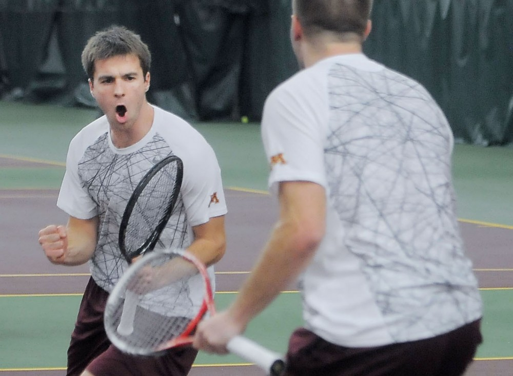 Minnesota doubles partners Mathieu Froment and Jack Hamburg celebrate after a victory against Tulsa at the Baseline Tennis Center.