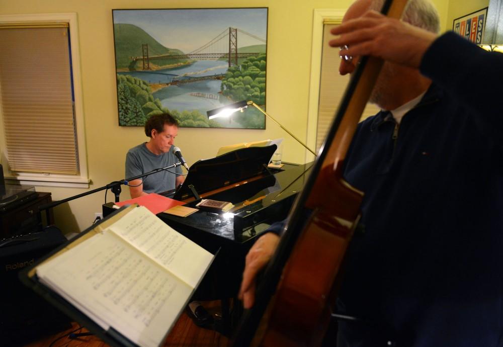 University adjunct law professor Larry McDonough plays an original composition entitled