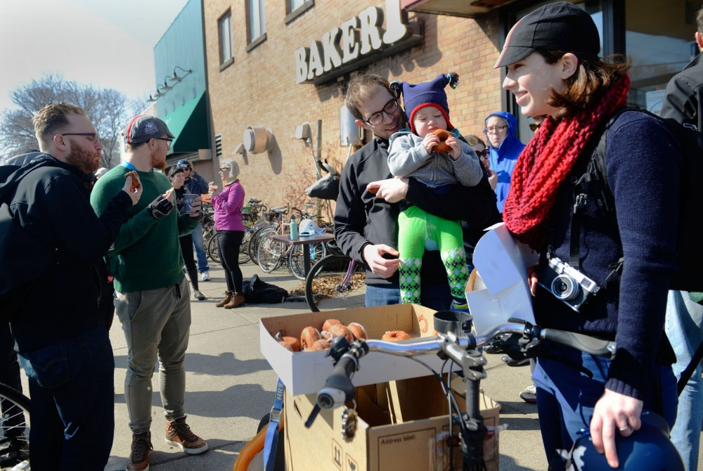 Bicyclists of all ages gather for doughnuts at the end of Calhoun Cycles Pastry Ride at A Bakers Wife on Saturday. The ride is a part of 30 Days of Biking, a yearly event in which people pledge to ride their bikes every day of April.