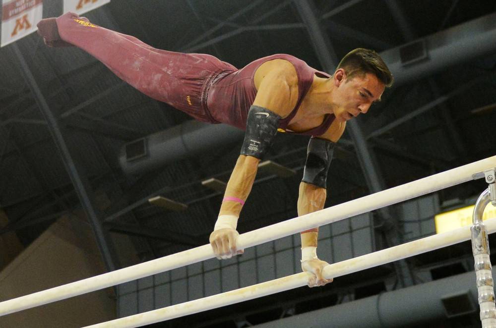 Senior Steve Jaciuk competes on the parallel bars against Iowa on March 7 at Sports Pavilion.