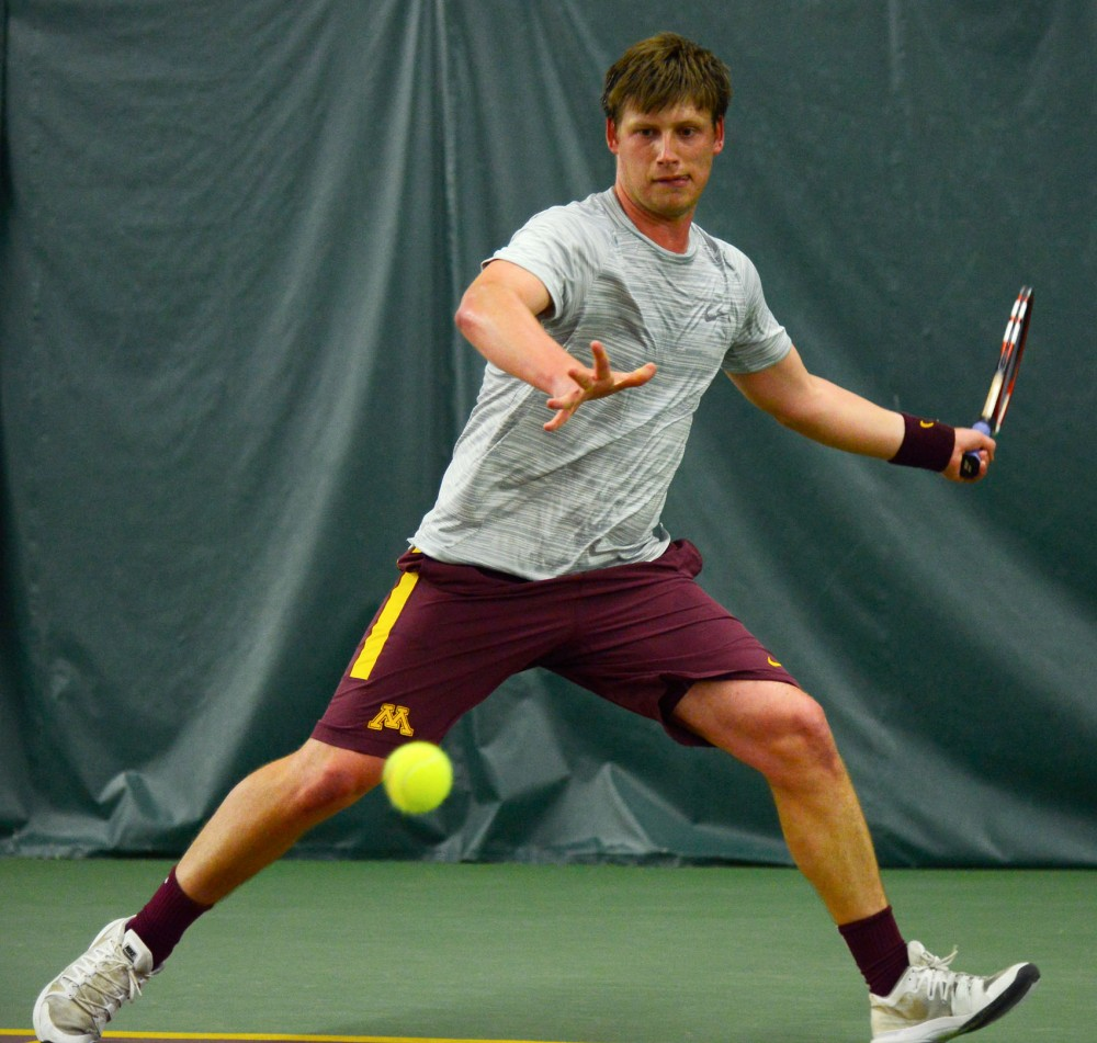 Senior Leandro Toledo volleys the ball at the Baseline Tennis Center on March 27 against Purdue.