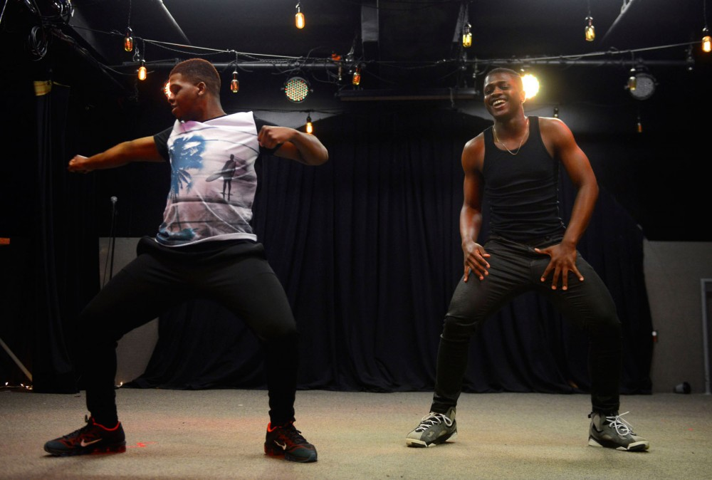 Minneapolis residents Kenneth Williams, left, and Blake Brown perform a choreographed dance at the QIPOC talent show at The Whole Music Club in Coffman Union on Sunday evening.