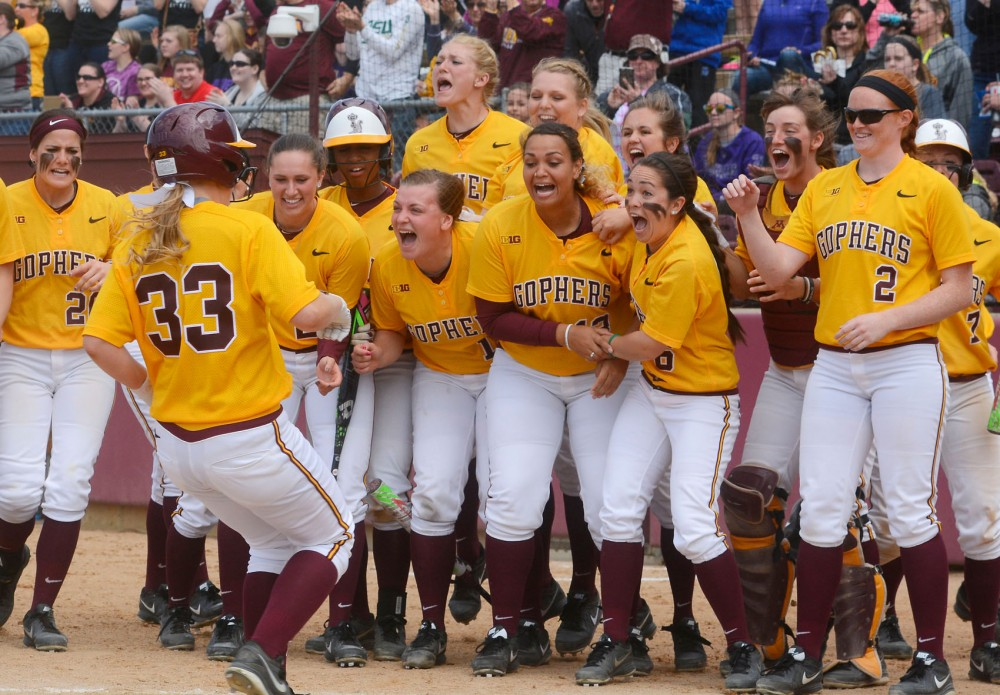 The softball team celebrates Ellie Cowger's home run on Sunday afternoon at the Jane Sage Cowles Stadium. The Gophers won against Northwestern 11-0.