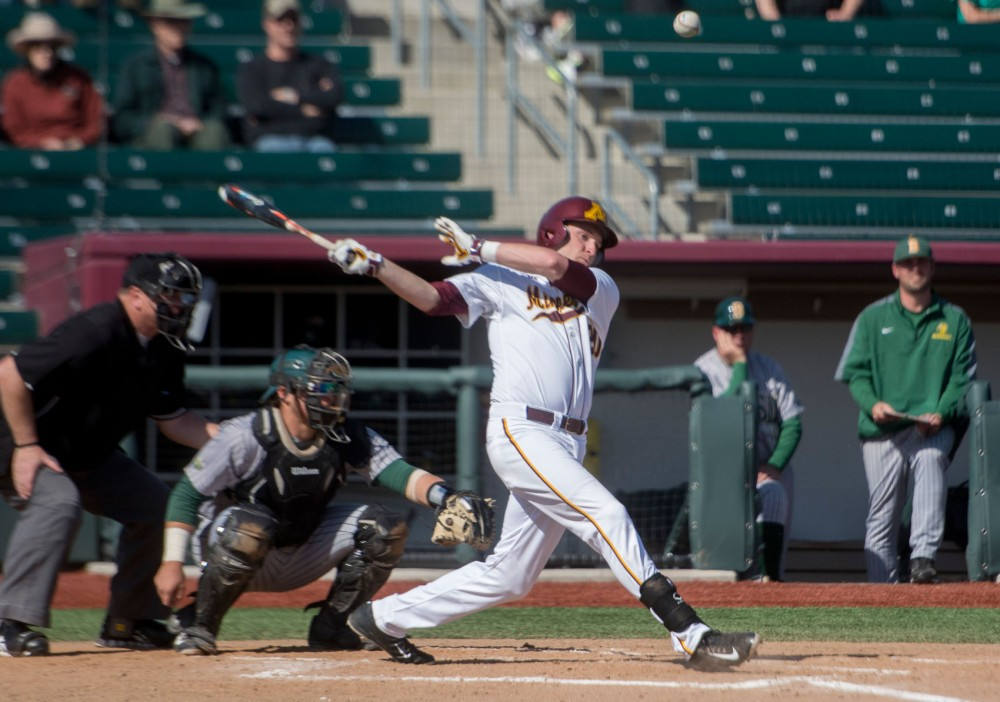 Freshman Toby Hanson hits the ball on Tuesday afternoon at Siebert Field.