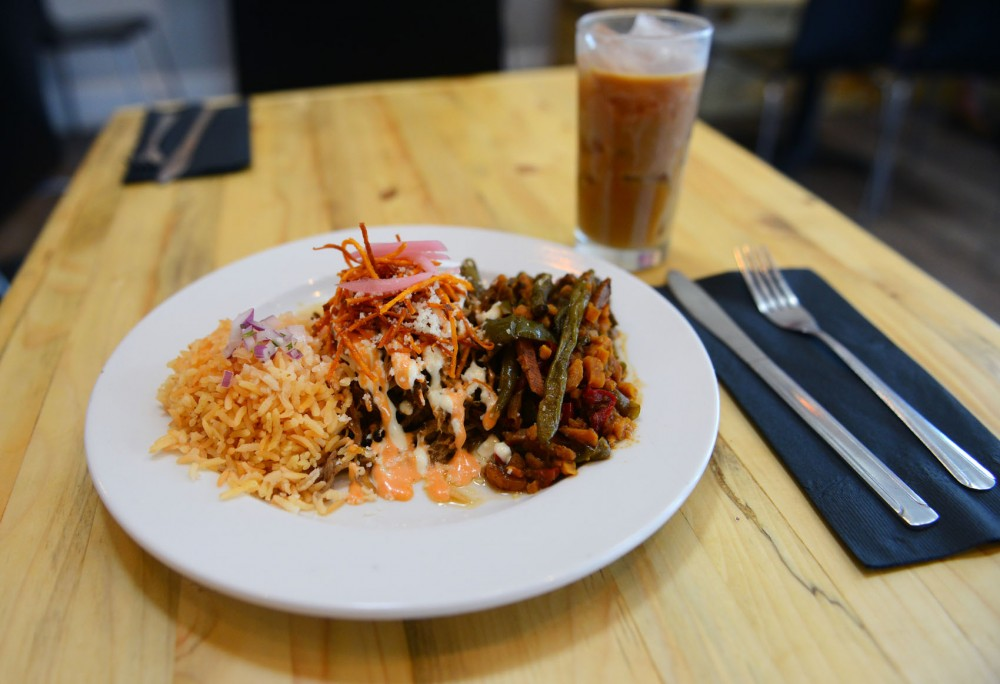 Pulled pork, sazón rice and roasted vegetables are just a few of the Columbian-influenced menu options at Café Racer Kitchen in Minneapolis on Sunday.