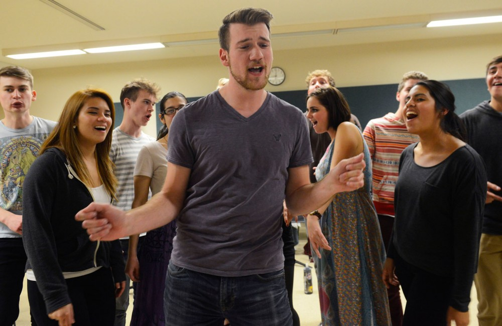 Urban Sound, a co-ed a cappella ensemble, rehearses in Ferguson Hall on Monday. The group is one of five a cappella groups that will be performing at the University A Cappella Fest at Coffman Union on Saturday.