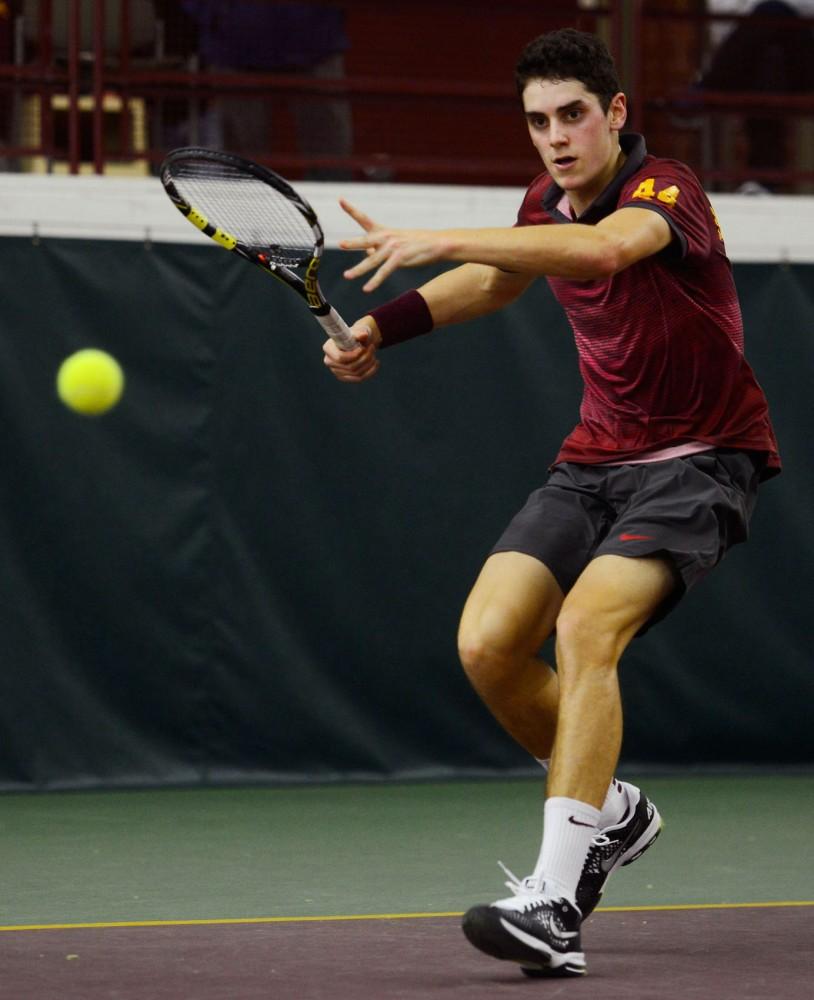 Freshman Felix Corwin volleys the ball at the Baseline Tennis Center on March 6 against Washington.