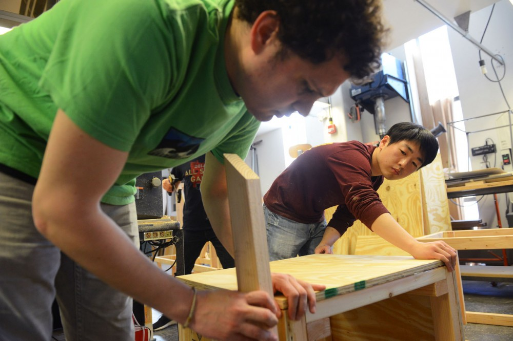 Graduate students Alberto Babio and Deuk-Geun Hong build WAMs upcoming pop-up park in the W.L. Hall Workshop inside Rapson Hall on Sunday. Created by the WAM Collective student group, the park will take over the museums front plaza from April 20 to May 10.