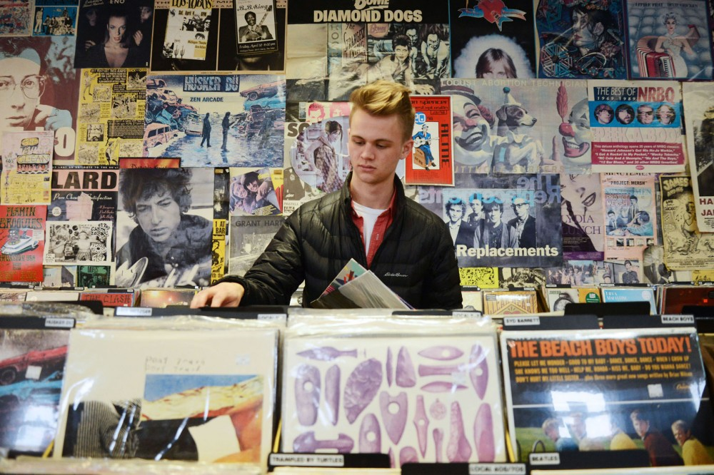 Global studies and history major Tyler Boesch looks at vinyl records at Treehouse Records in Minneapolis on Jan. 19.