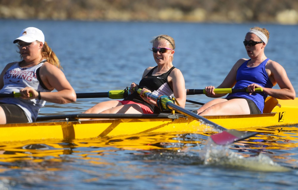 Junior Kylie Anderson rows on the Mississippi River on Tuesday afternoon with her teammates in preparation for their trip to compete in the Clemson Invite in South Carolina.