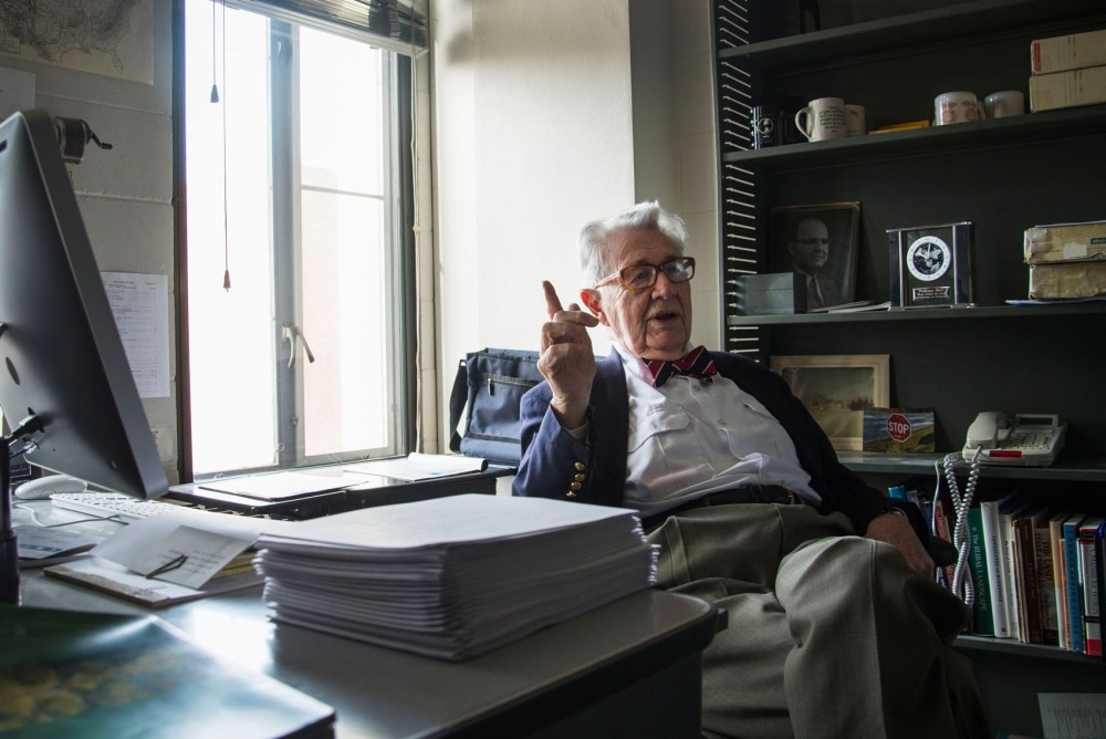 Geography professor John Fraser Hart talks about his history of teaching in his office in the Social Sciences building on Wednesday. Hart, 91, has been teaching at the University for 48 years and plans to retire after this semester.