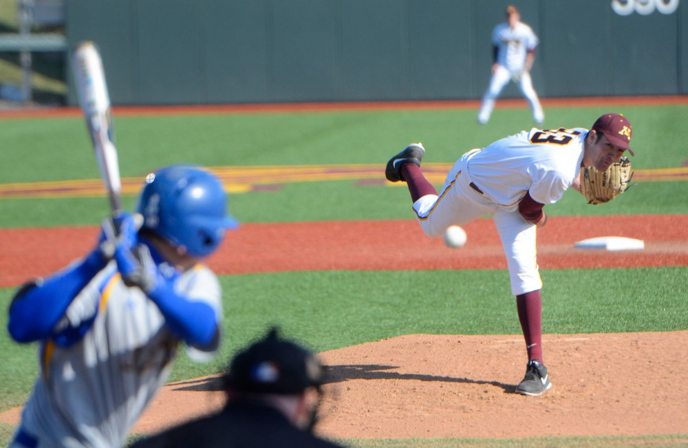 Sophomore Toby Anderson delivers a pitch Wednesday afternoon at Siebert Field.
