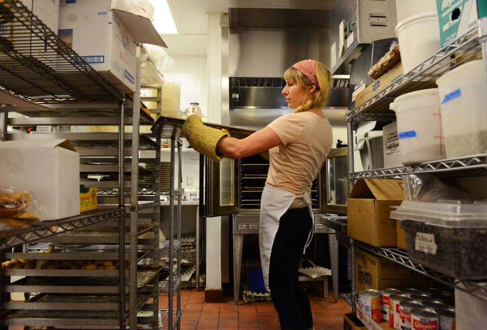 Junior Ella Masters works as a cook at Butter Bakery Cafe on Sunday. She has duties ranging from roasting turkeys and preparing salad dressing for the kitchen line.