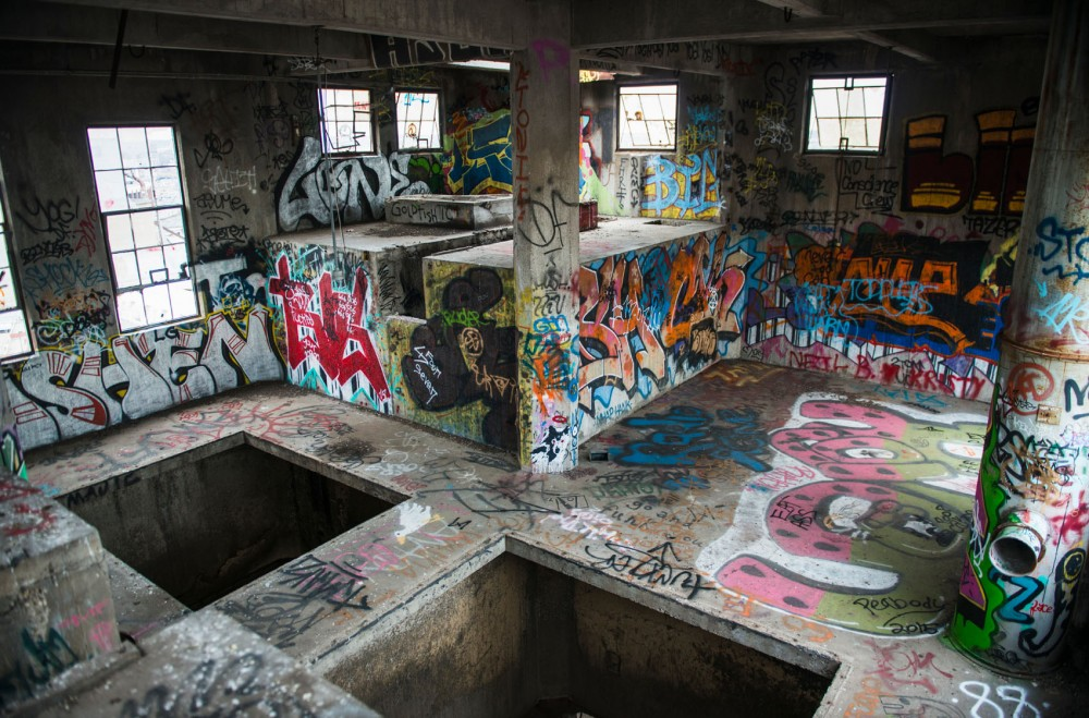 Graffiti is painted on the walls and floor of an abandoned grain elevator. The owner of the Prospect Park property, John Wall, said he spends thousands of dollars to erase the art but new tags constantly appear, year-round.
