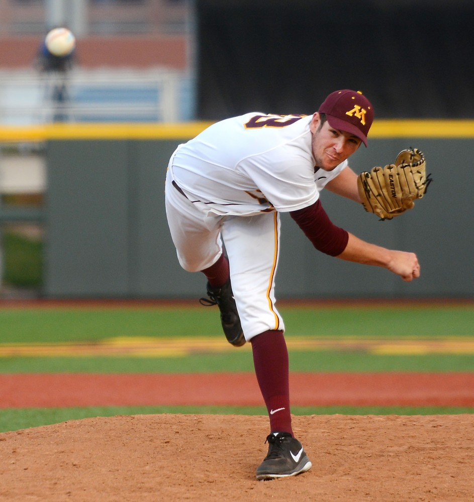 Gophers pitcher Toby Anderson throws the ball against Kansas State at Siebert Field on April 29.