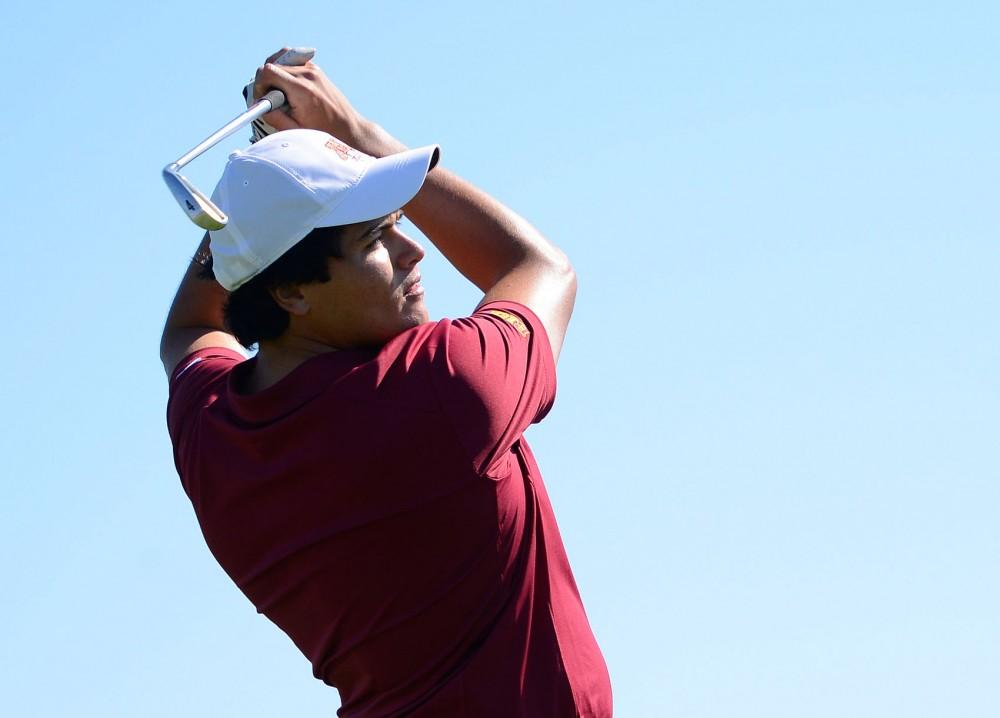 Sophomore Jose Mendez swings at Windsong Farm Golf Club on September 7, 2014.